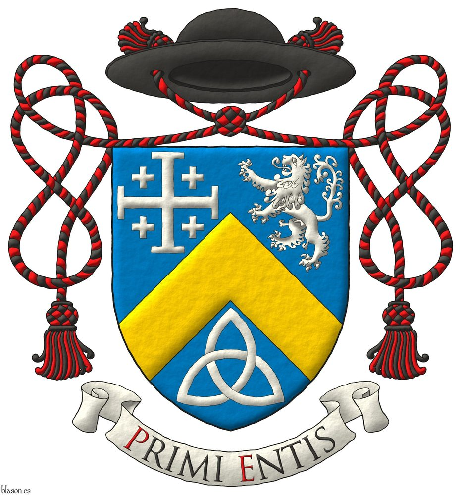 Azure, a chevron Or, between in chief a cross potent cantoned of crosslets, and a lion rampant, and in base a Celtic Trinity knot Argent. Crest: A galero Sable, with two cords, each with one tassel Gules and Sable. Motto: «Primi entis» Sable, with initial letters Gules, over a scroll Argent.